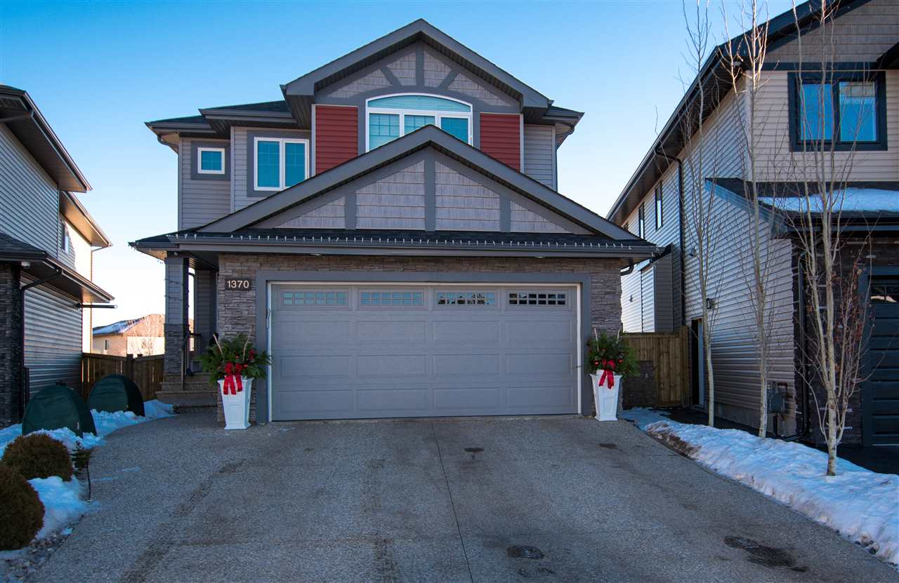 """Exquisite, 4 bedr (all upper level!) home in the new, vibrant family comm. of Callaghan. Every """"move in ready"""" detail has been thought of in this 2 storey beauty! A sizeable tiled foyer leads into a fully open concept LR/Chef's kitchen and dining area with rich/dark maple hw flooring. Dream kitchen with white, modern soft closing cabinetry, luxurious granite counters, Kitchen Aid appliances including dual oven, and a walk through pantry!  Spacious master (partial vaulted ceiling), w/ generous walk in closet (built ins) and a 5 piece ensuite to die for - granite counters, dual sink, tiled double wide stand up shower, and soaker tub - Wow! Remaining 3 """"roomy"""" bedrooms all have built in closet shelving. 4 piece bath, again with granite counters, completes the upstairs. Other features of this must see home include: A/C, Nest thermst., 4 zone sound syst. incl. amp, mud room and m/fl laundry, aggreg. driveway and lower patio, all A/G LED lighting, and 23 ft deep INSIDE measure, heated truck friendly garage."""