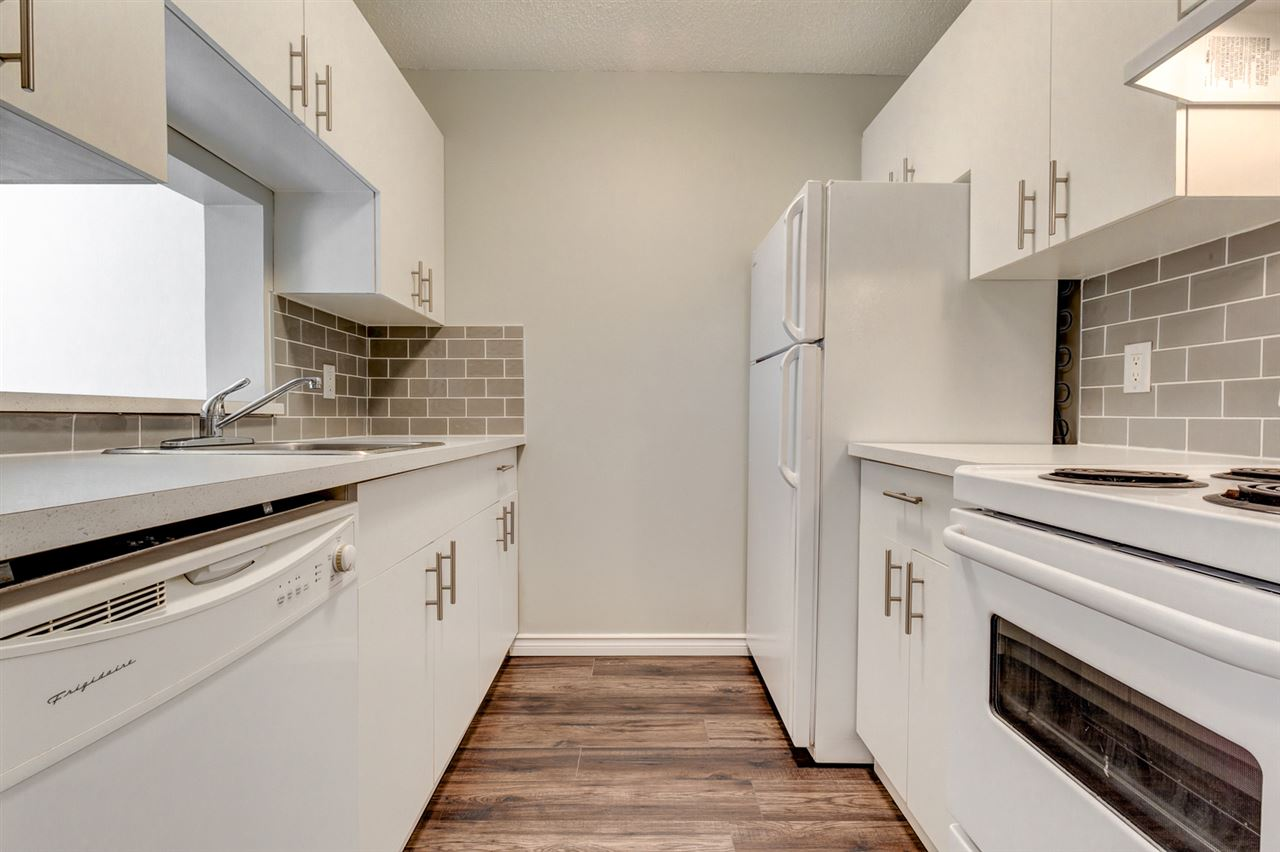 ***PRICE REDUCED*** This COMPLETELY RENOVATED unit is great for investors or first-time buyers looking for a modern yet affordable unit with LOW CONDO FEES. This 1 bed/1 bath has tons of natural light, a balcony, same floor laundry, and a spacious STORAGE ROOM inside the unit to store all your clutter. The renovations include but are not limited to NEW KITCHEN, NEW BATHROOM, NEW LIGHTING, and NEW LAMINATE FLOORING THROUGHOUT. Can't go wrong with this centrally located condo just minutes away from the City Centre. This building even has a grocery store on the main floor for convenience!   **Parking available from condo management company for $25/month**