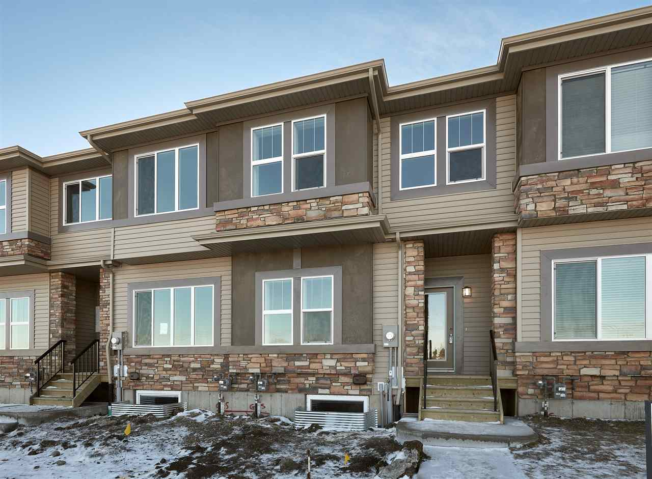 Welcome to the new community of Riverview! This beautiful 2 storey townhome (Optima II) built by Daytona Homes has NO CONDO FEES & double ATTACHED GARAGE (19.7x17.7)! This home offers 3 bedrooms, 2.5 bathrooms, and 1428 sqft of living space. Entering the home you will  love laminate flooring through-out the living room and dining area. The kitchen features plenty of cupboard and counter space, a full height ceramic tile backsplash, large island with breakfast bar, and a pantry, a 1/2 bath complete the main floor. Upstairs is a spacious master bedroom with a walk-in closet and a 3 piece ensuite, 2 good sized children's rooms, a main 4 piece bathroom and laundry room complete the 2nd level. Riverview is a terrific neighbourhood, and you are just minutes from great schools, shopping, parks, golfing, and more! Front landscaping and deck included!