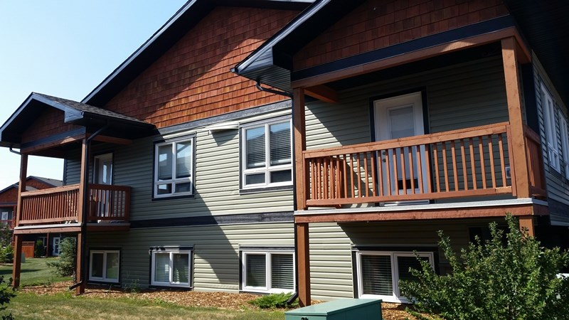 Begin home ownership here!! This main level of this unit features an open concept with spacious kitchen and living room, a 2 piece powder room and balcony.  Gorgeous kitchen cabinetry with granite counter-tops, raised breakfast bar, stainless steel appliances  and corner pantry. The lower level has 9 foot ceilings, insuite laundry, master bedroom with 4 piece ensuite and walk in closet a den and furnace room.  To top it off you have  covered assigned parking with plugin, storage locker and guick access to hwy 16A.