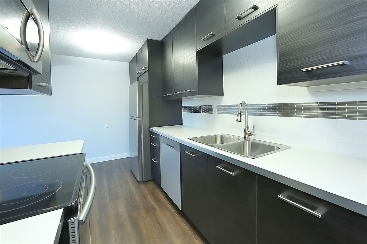UNBEATABLE VALUE in this spacious  2 bedroom, full bathroom condo in West Edmonton! Beautifully RENOVATED, this modern home has been updated to include all new laminate flooring, lighting fixtures, backsplash in kitchen, plumbing fixtures, neutral paint throughout, and more! The bright kitchen offers dark custom cabinets with cabinet style pantry, modern tile backsplash, new appliances and a large dining nook. Spacious & inviting, the living room is perfect for entertaining- complete with patio doors leading to the private balcony.  The main bathroom has been tastefully updated to include a soaker tub, custom tile surround/floor,  new fixtures and toilet. Located minutes away from the future LRT, West Edmonton Mall, and only a short drive to downtown, Whitemud  and the Anthony Henday Dr.