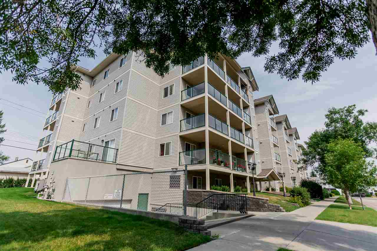 Lovely top floor, 751 sq ft, 2 bedroom, 2 bathroom condo with 9' ceilings located in Summit Peak with a south facing balcony!! Recently painted with new laminate flooring. Nice open floor plan. The kitchen is spacious with a great amount of oak cabinets. The spacious master has a walk through closet and 4pc ensuite. There is in suite laundry with stackable washer and dryer. Never scrape ice off of your windows again with the heated underground parking, or better yet just walk a few short blocks to downtown shopping, the library, parks, theater, etc. The building also gives you access to a common exercise room as well as a party room for entertaining!  Condo fees include heat & water as well! This adult only building is perfect for a rental property, or if you are looking to downsize!