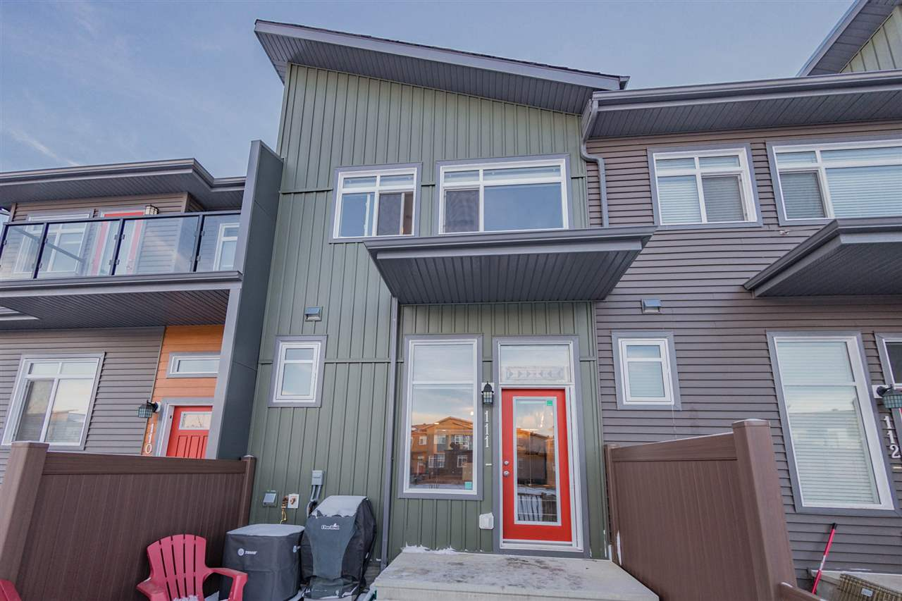 Welcome to Novus, this 2-storey townhome has it all! Discover this well designed 2 bedroom, 2.5 bath, double attached garage townhome, with over 1000 sqft. of living space. The open concept main floor boasts a front foyer with closet, 2 piece powder room with pedestal sink, living room, dining room, and kitchen. Enjoy the modern L- shaped kitchen and an extended eating bar offering room for 4 chairs. Plenty of counter and cabinet space and fully equipped with stainless steel appliances. The spacious living room, with beautiful wide plank laminate, will accommodate all your needs! Upstairs are the 2 bedrooms each with their own ensuite. In the basement is the laundry space with washer and dryer, storage area and utility. The double attached tandem garage offers safety and convenience to the homeowner. In the front of the home is the fenced in front yard and patio with a view of the park, which is perfect for entertaining!
