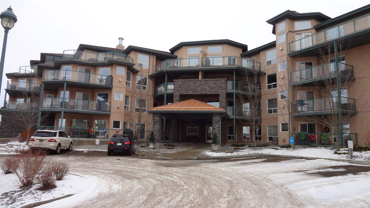 Are you looking for care free living in one of the finest 18+ condos in the Greater Edmonton area? Your search is over! This building offers many rare features: a well equiped fitness room, a meeting room with a kitchen & bathroom, and a fully furnished guest suite available @ only $25/day. The upscale luxury and quality is evident from the grand main entrance with a curved stairway and throughout the entire property! Built by the award winning Christenson Developments and conveniently located in the premeire community of Bridgeport. Steps to all amenities and adjecent to a park space! This well maintained home shows pride of ownership! It's a spacious, bright unit with an open floor plan. Upgrades include: a seperatly titled heated parking stall with a large storage unit, gleaming hardwood floors, upgraded kitchen cupbords, stainless steal appliances,  a large Storage/Laundry room, Gas Fireplace and your own forced air Furnace with central Air Conditioning just to name a few! Beautiful and spotless!