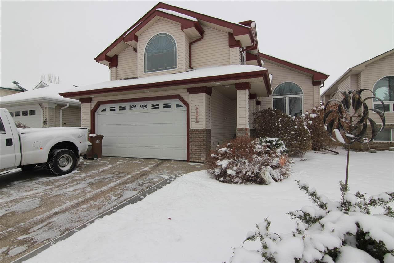 Location location! Situated on a quiet street backing POND and green space, this custom built BUNGALOW is immaculate and move in ready. The main floor features a front flex room off the entrance, perfect den, formal dining or home office space. The great room has soaring VAULTED ceilings and is open concept to the kitchen. There is a 3 sided gas fireplace and windows overlooking the beautiful view. The kitchen has new GRANITE counter tops, corner pantry and large island. Completing the main floor is laundry with access to the fully finished HEATED garage, master bedroom with 4 piece ENSUITE and half bath for guests. Upstairs is a bonus room/loft with gas fireplace and vaulted ceilings. The basement is finished with an additional 2 bedrooms with walk in closets. Family room features a 3rd gas fireplace and storage! Maintenance free deck with hot tub and central AIR CONDITIONING!