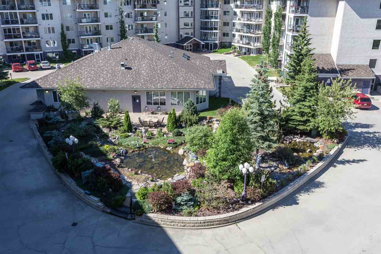Wow, this unit has in all, SOUTH facing TOP FLOOR over looking a GORGEOUS POND, in the well sought after community of Tawa. Features a large coved kitchen with plenty of cupboard space, dining area, living room with a corner Gas Fireplace and a patio door leading to a balcony. As well there is a large master bedroom with a walk in closet and a 4 piece en-suite, a Den that could easily be used as a second bedroom, 4 piece family bath and a nice sized laundry room with some storage space. Comes with 2 TITLED STALLS and 2 Storage Gages. Amenities include, a weight room, sauna, steam room, wood shop, car wash bay, Guest Suite rentals. What a great place to call home and is a real pleasue to show.