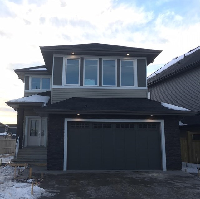 STUNNING Brand New, 2 Storey Home is ATTRACTIVE & MODERN both Inside & Out, Features 2364 sq ft of Luxury Living Space, Excellent Curb Appeal with Stone work, Double Attached Garage with water drain. Main floor boasts 9 Ft Ceiling, 8 Ft Doors, Inviting Living Room, Large Windows & Gorgeous Fireplace with stone work, Gourmet Kitchen w/ Quartz Counter-Tops; Stainless Steel Built in Appliances with Gas Cook Top; Huge Island; Ample Cabinets; Walk through pantry; Glass Tiled Back splash; Good sized Dining Area, Main floor Den / Flex Room.Upstairs offers Spacious Bonus Room, Master Bedroom with 5 piece en suite & Walk in closet with Custom Shelving, 2 Additional Bedrooms & Laundry.Builtin Speakers with 4 Zones Volume Control, Cat5 Wiring, Upgraded Lighting Fixtures, Glass Maple Railing, South Facing Deck with Gas line, HRV, Triple Pan Windows.Separate entry to basement for feature suite. Close to golf course, shopping, public transit, and enjoys easy access to Henday. Come and make your dream true. Show 10 !!!