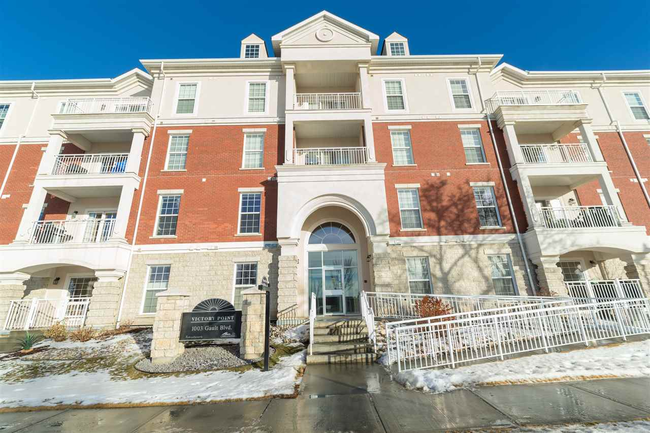 Welcome home to this TOP FLOOR 2 bedroom 2 bathroom condo with 2 TITLED UNDERGROUND Parking Stalls!  Located in Griesbach, one of the most desirable neighborhood's in Edmonton.  This large unit has 9' ceilings, an open concept, a large balcony, and a fireplace.  Bedrooms are on either side of the unit which make them very private, including the master bedroom complete with a walk in closet and full ensuite.  Top of the line kitchen offers upgraded cabinets, granite counter tops, and stainless steel appliances.  This building is concrete and steel frame construction, which makes it very quiet and an excellent investment. The building has many amenities including a roof top patio, exercise room, and a social room. Located in the heart of the city but in a new neighborhood this home has everything to offer - close to all amenities, only minutes from downtown, very close to the Anthony Henday, and surrounded by schools and shopping.  Excellent unit in Fantastic condition, for an amazing price!