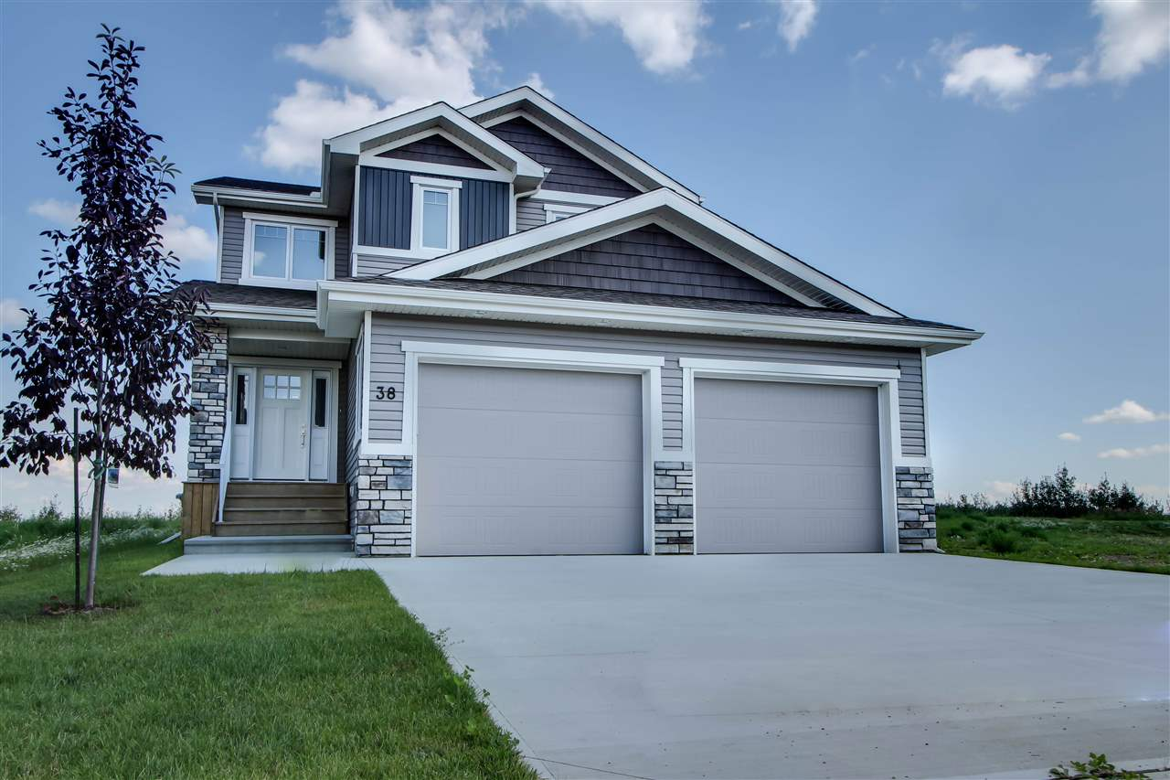 Evani Homes has created a stunning, custom built 2 storey in Deer Park that's loaded with upgrades! This modern, open concept home features large windows, beautiful kitchen with white cabinetry that reaches the 9' ceilings, two tone quartz countertops, s/s appliances, glass tiled backsplash, built in vacuum sweeps, custom built walkthrough pantry, spacious den, cultured stone fireplace with built in shelving, maple railings, ceramic tile and scraped hardwood flooring. Upstairs you have a generous bonus room thats media ready, 2 bedrooms plus a spa inspired master suite oasis with a large tiled shower, stand alone soaker tub and a large walkthrough closet with laundry room access for Your convenience. Attention to detail is found throughout the entire home and anyone would be proud to call it their own.