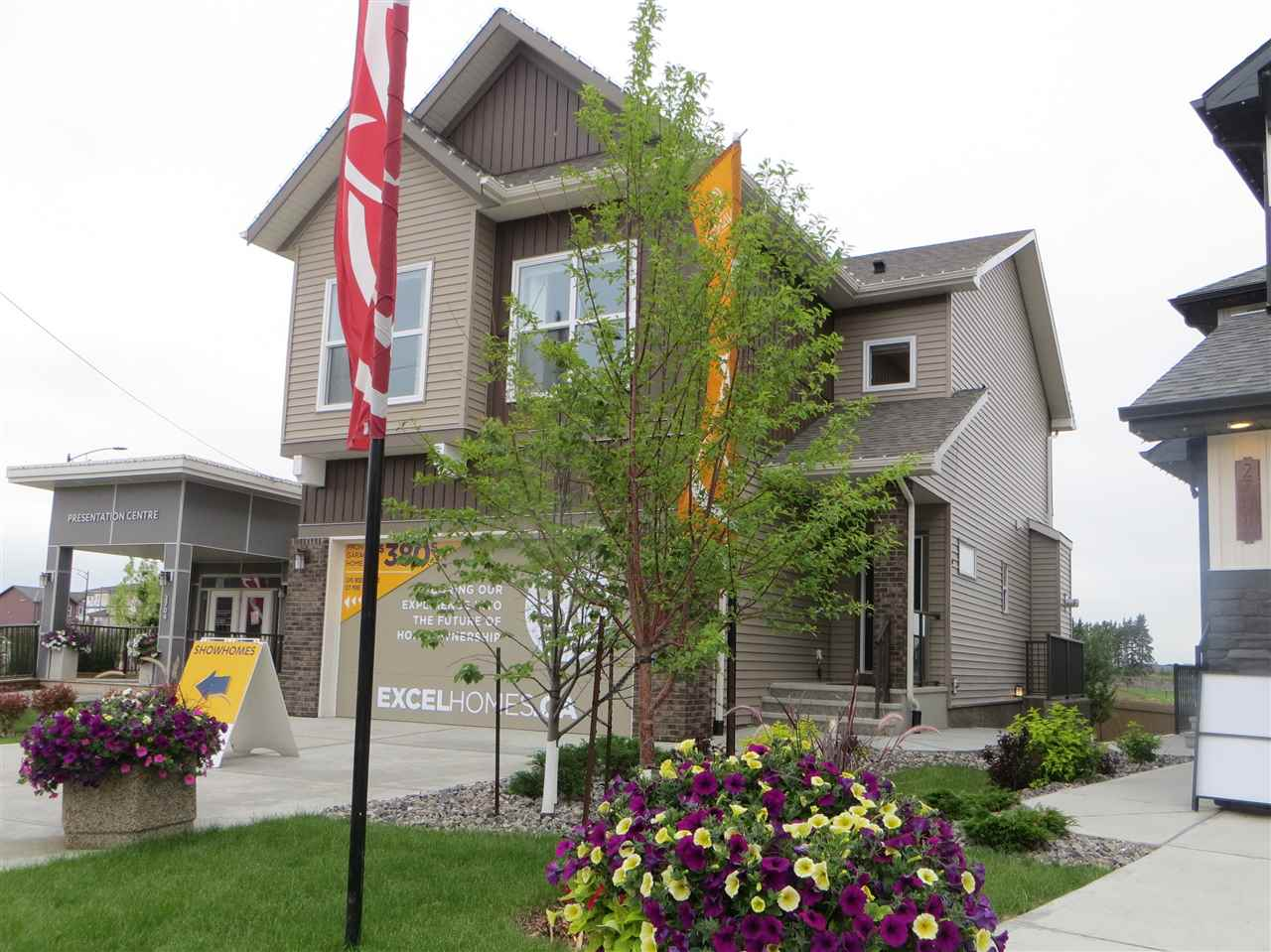Interested in having the builder make your mortgage payments? Take advantage of today's prices and have builder leaseback from you. This showhome is loaded with extras, over 2000 sq ft plus finished basement w/ separate exterior entrance!  9' ceilings on main and upper floor really opens up the living space.  The chef's kitchen w/ clean lines features pot and pans drawers, island, granite counters of course, pantry, crown moulding and equipped with stainless steel appliances.  Deck off the dining room has a gas line roughed in as well for bbq's!  Hickory hardwood floors, tile flooring, gas fireplace and pot lights are just some of other upgrades.  The upper level has a bonus room, 3 bedrooms including the master bedroom with walk in closet and ensuite with his and her sinks.   Laundry area is also on the upper level for added convenience. Fully landscaped plus there is central A/C! Basement has a 4th bedroom, recreation room w/ wet bar and 3 piece bathroom w/ it's own entrance. Measured to RMS standards.