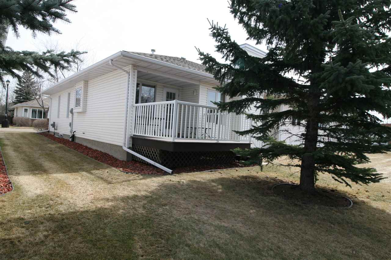Great adult living 45+ Low Condo Fees - Well run self managed project. Excellent Bungalow floor plan. Renovated kitchen with amazing Island open to living room with quartz counter tops. High-end appliances. Large living room with vaulted ceilings and new hardwood floor. Over $40,000 in renovations in 2017. Spacious master suite with 3 pce ensuite. Main floor laundry with laundry sink. Basement is partly finished with 3pc bathroom, rec-room or a bedroom (has walk in closet).  Balance of unfinished basement is waiting for your personal touch. Double attached garage, RV parking area within a complex. Good size yard and newer deck.