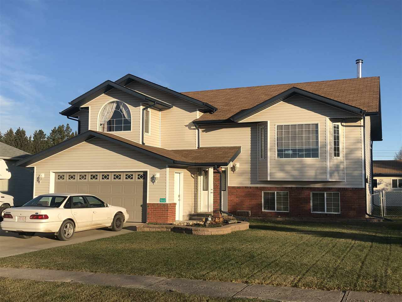 Built in 2005, this bi-level is sure to please. Located in the wonderful community of Pickardville, just 10 minutes to Westlock, 50 minutes to Edmonton. Spacious great room with oak kitchen, island, corner pantry.  Hardwood in the living room and down the hallway.  Ceramic tile in the kitchen. This home has 3+2 bedrooms & 3 bathrooms.  Vaulted ceilings with recessed lighting. Bay living room window.  Master has a 3 piece ensuite, walk-in closet, & den. The home & both garages have 2x6 exterior walls.  Large double attached garage, a double detached garage, & room for RV parking. Basement is fully finished with a large family room for entertaining. Custom white-colored woodstove with a brick surround.  Office area. 3 piece bathroom. Fenced yard.  Concrete patio deck.  Main garage has a floor drain and is finished inside.  2nd garage is finished & insulated, has power, cupboards, & 2 electric heaters. This home could use an interior paint job, so the seller is offering a $7,000 paint credit to the Buyer.