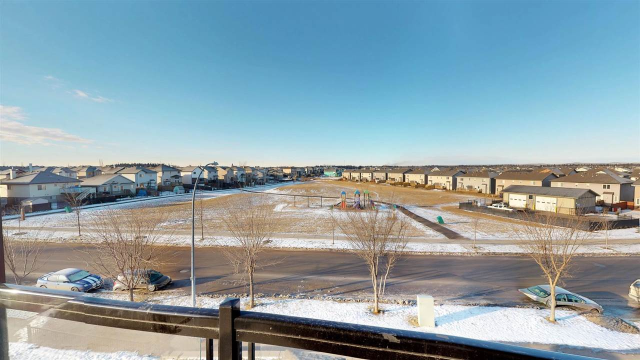 LOOK AT THIS VIEW FROM YOUR BALCONY!! 3rd floor, 2 bedroom, 2 bathroom condo LOOKING OVER THE PARK. Beautiful, new hardwood flooring, stainless steel appliances, island and pantry. New paint throughout. IN-SUITE LAUNDRY and AIR CONDITIONED. There is 1 assigned stall in the underground, heated parkade and additional above ground parking available. Within walking distance to the Tri Leisure Centre and shopping.