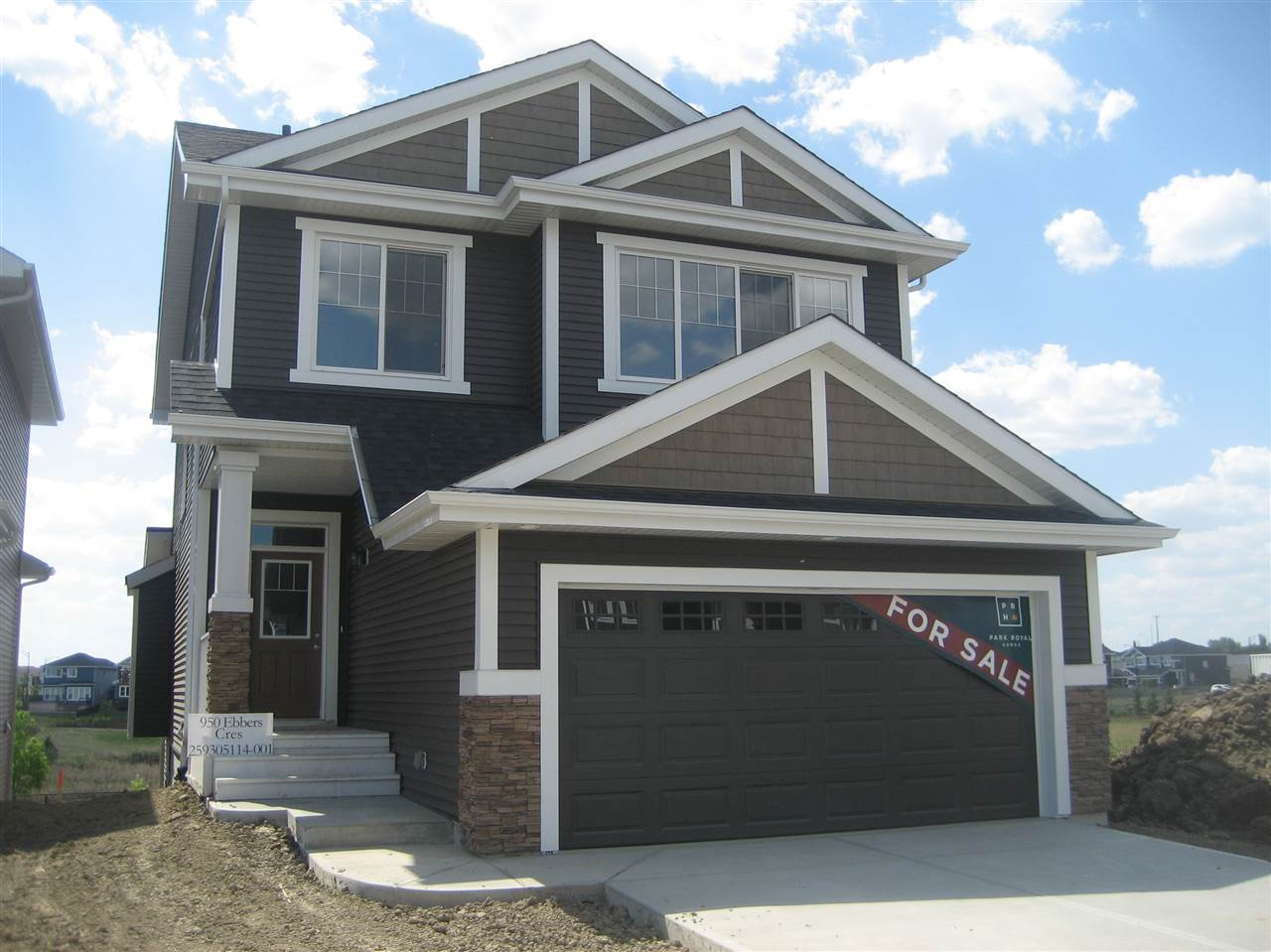 The Glamis Craftsman by Park Royal Homes. Unique two storey homes with walk out lower level backing onto park with south facing backyard. Open plan with engineered hardwood and ceramic tile flooring. 9 Foot ceiling on main. Open kitchen with large island, modern white cabinets, corner pantry and quartzite counters. Living room with gas fireplace. Patio doors of the nook to large deck with aluminum railing overlooking the park. Owners suite with tray ceiling, large ensuite with his and hers sink, walk in closet. Spacious walk in laundry room. Bonus room with tray ceiling (10ft ceiling) over the garage. Excellent size secondary bedrooms. Refundable landscape deposit due on closing. Taxes only partially assessed. Price incl. GST. Price incl. $3200.00 appliance gift certificate.