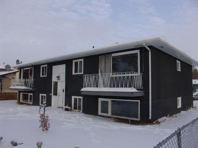 NOW IS YOUR CHANCE!  INVESTORS, this 4 PLEX has an excellent unit mix of 3 ? 2 bedrooms & 1 ? 1 one bedroom unit.With newer roof,newer Hot water tank & 2 efficient,easy to maintain,natural gas forced air Furnace?s means you can keep your maintenance cost low.Owner owned MAYTAG coin operated WASHER & DRYER,for nice CASHFLOW. Fenced yard & a secure front entrance is perfect for your tenants.front foyer leads up or down with newer common area carpets & storage areas.Sunny lower level units with big bright vinyl windows,laminate flooring & large room?s makes these units above the rest.Upstairs enjoy the balconies,ceramic tiles & more.Outside a storage shed with more income potential & nice fenced yard for families to play.EVEN FIRST TIME HOME BUYERS CAN! Enjoy the benefits of home ownership & investing at the same time,while your tenants pay your mortgage for you, LIVE IN ONE UNIT- RENT OUT THE REST. STRONG CAP RATE, Convenient location, shopping schools, highways all nearby makes this IDEAL!