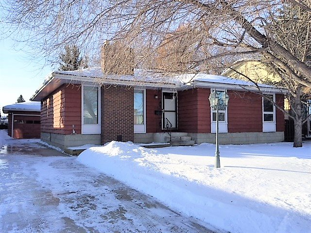 ***4 Bedrooms on the Main Floor***Completely Renovated Modern Style Kitchen with Custom Lighting***Hardwood Flooring*** These are some of the features this beautiful home has to offer. Downstairs you will also find a Huge Family room with Gorgeous Wood Stove. Also included is a Home Theatre Room, a Cold room, a Large Laundry room, and an Extra Room with Window. The Back Yard is Fenced and has Nice Mature Trees. You will find a Large Double Garage. There is an Entrance Door at the Back that allows you to go Directly to the basement.  All the 4 main level bedrooms have Hardwood Flooring. In the Large Living Room, you will find a Wood Burning Fireplace. The Kitchen has lovely French doors and lots of Natural Sunshine on top of being Splendid.  Upgrades include: All new wiring (2009 - full house) Fully wired with CAT 6 (2009) Home alarm system (2009) Roof with 25 year shingles (2009) New doors (2010) Some new windows (2010 / 2011) New hot water tank (2008) Sewer line re-lined in 2017 (10 year warranty)