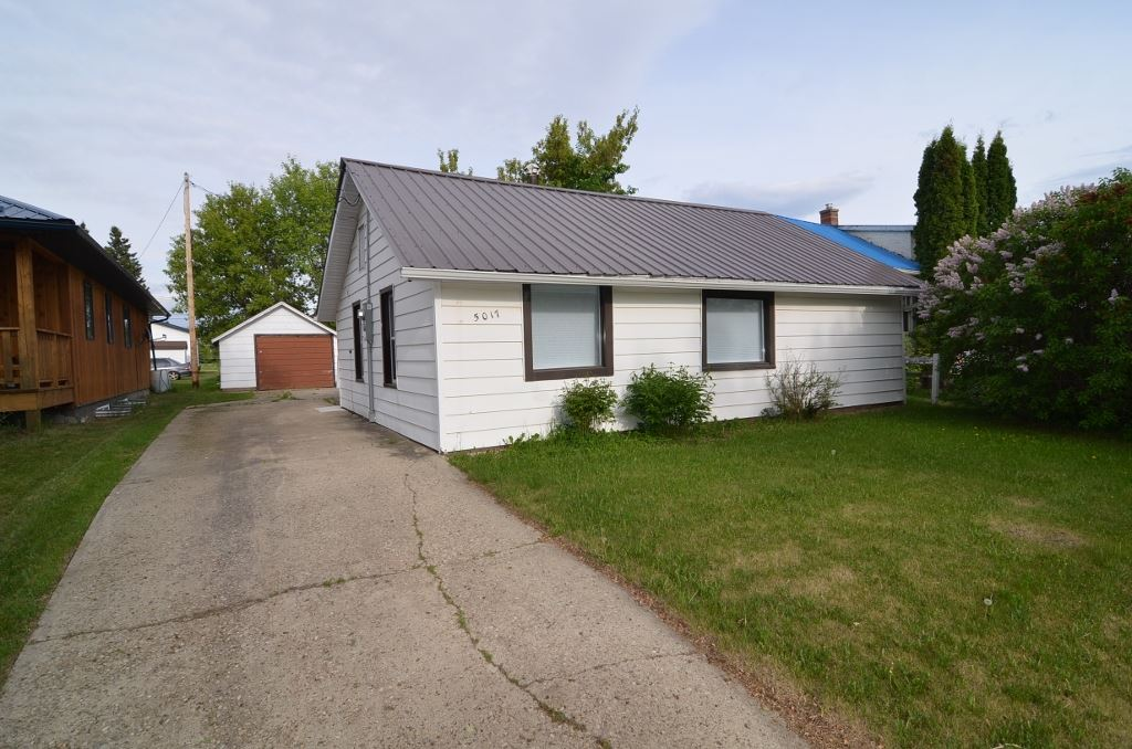 An affordable newly updated 2 bedroom home situated on a large lot for someone who needs a beautiful heated workshop 26 by 28 with a high ceiling along with an older single garage and storage shed. The home has been newly upgraded with  new flooring, ceilings, new bathroom,kitchen countertop, and much more!! Lots of parking by back ally. A must see!