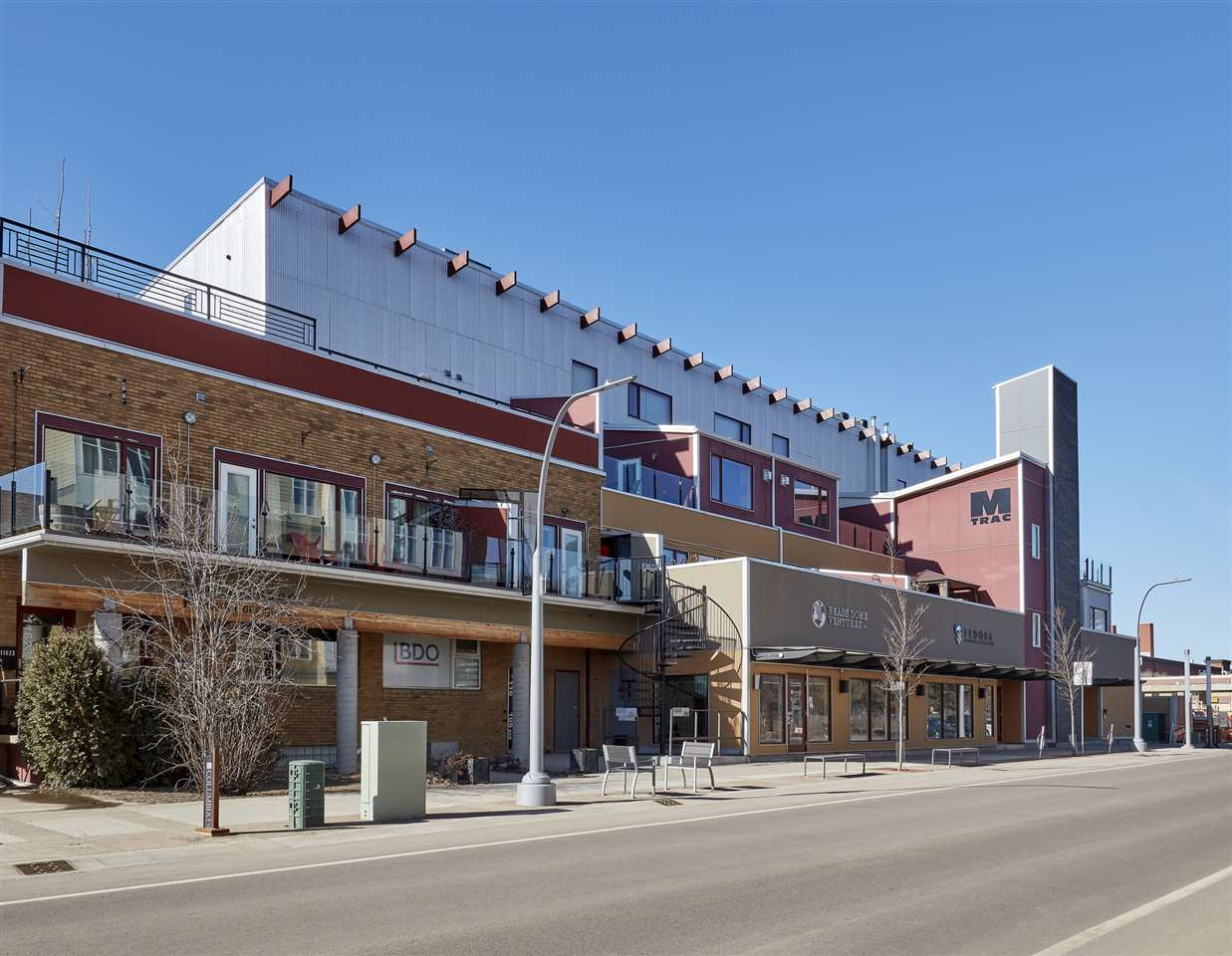 SOHO inspired lofts in the heart of YEG Brewery District. Can you imagine your own private entrance & private elevator that takes you to your top floor penthouse loft with sweeping downtown views! Over 2361sqft of finished living space ? 1 bed plus den & additional loft (mezzanine area), 2 baths ? 22 foot high ceilings & more! This stunning loft was fully renovated in 2013 to an incredible open beam modern style. Step inside, the stunning kitchen is a chef?s dream & open to the large dining area. Continue on into the large living room that is completely breath taking with floor to ceiling south facing windows. Through the patio doors ? the outdoor living space is almost 3000sqft with city views; hot tub, outdoor kitchen, dining areas & places to just relax & enjoy the views. Back inside the master bedroom is a great size with a fabulous master bath. The den is bright & open, can be used as a bedroom, 4 piece bath, 2 parking stalls & separate storage unit complete this executive loft! Walk to every amenity