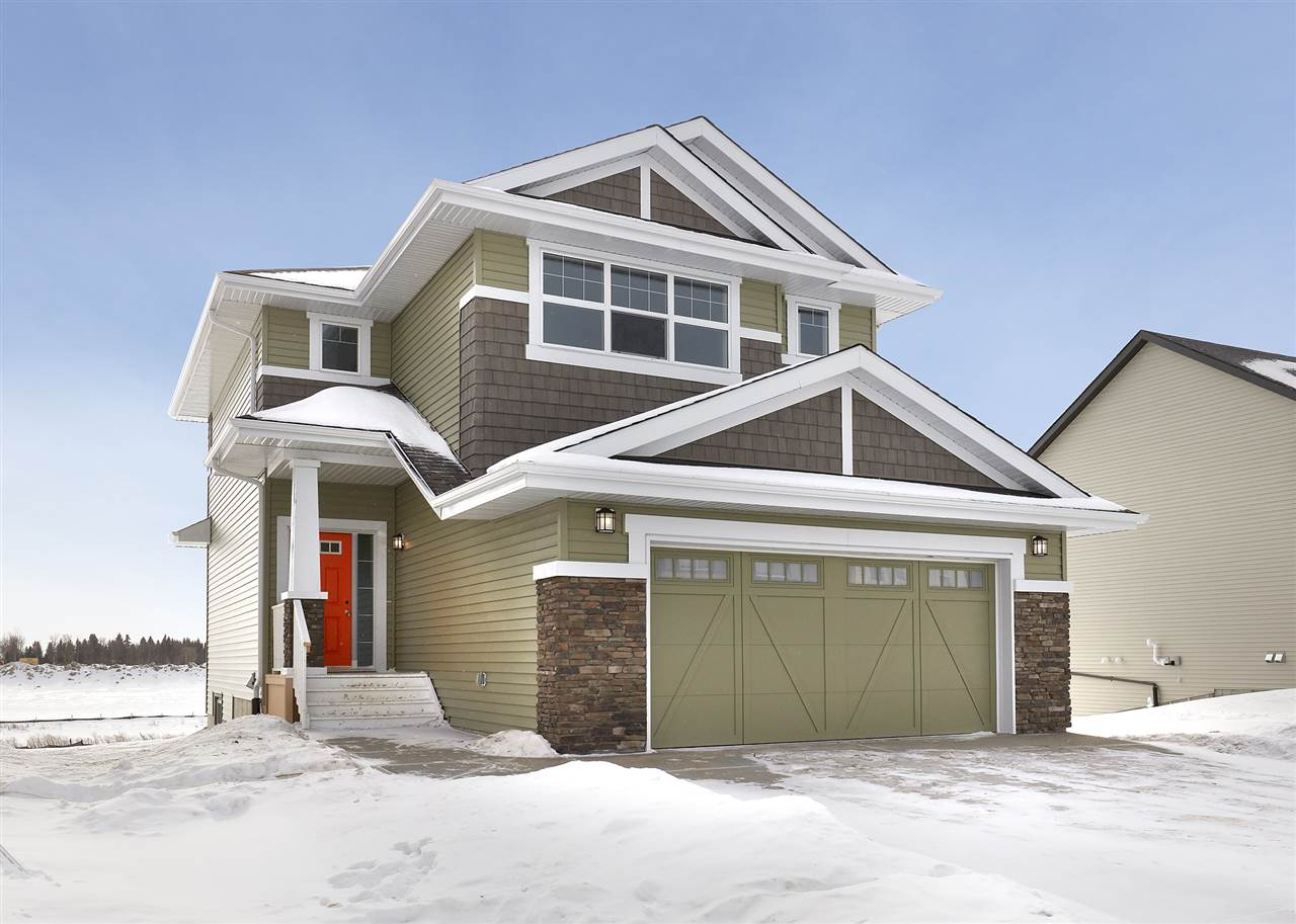 Welcome to Edgemont. Small town feeling in the big city of YEG! The Tahoe II built (2017) by Daytona Homes is a 1761sqft wonderful family home -A Partial Walkout ? 3 beds, 2.5 baths! Over sized double garage - A spacious foyer welcomes guests. You will love the open concept style ? laminate & tile flooring throughout & 9 foot ceilings on the main floor. The Kitchen is beautifully finished with quartz countertops, beautiful cabinets, a prep island, an extended eating bar, ceramic backsplash, a pantry & a spacious breakfast nook! The large living room features a gas fireplace on side wall, the private den/home office & powder room complete the main floor. Retreat upstairs to the spacious master suite, which features a 4 piece ensuite (2 sinks & extra large shower) & a walk in closet. Both children's rooms are a good size, the large bonus room is the perfect place to relax with the family, upper laundry & 4 piece bath complete this level. Partial Walkout, Garage Widened by 4 feet, 10ftx13.6ft deck included