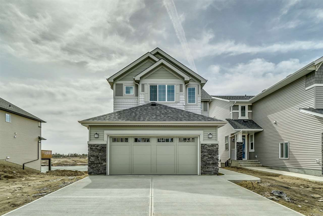 Welcome to Edgemont. The Tahoe II (H) (2017) built with Walk Out basement backing onto pond by Daytona Homes is a 1758sqft wonderful family home ? 3 beds, 2.5 baths! A spacious foyer welcomes guests. You will love the open concept style ? laminate & tile flooring throughout & 9 foot ceilings on the main floor. The Kitchen is beautifully finished with quartz countertops, beautiful cabinets, a prep island, an extended eating bar, ceramic backsplash, a pantry & a spacious breakfast nook! The large living room features a gas fireplace, powder room & mudroom complete the main floor. Retreat upstairs to the spacious master suite, which features a 4 piece ensuite (2 sinks & extra large shower) & a walk in closet. Both children's rooms are a good size, the large bonus room is the perfect place to relax with the family, upper laundry & 4 piece bath complete this level. The walkout basement is unfinished & waiting for your final touches!
