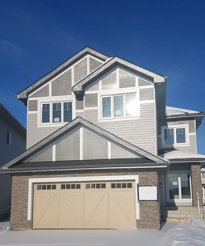 STUNNING Brand New, 2 Storey Home is ATTRACTIVE & MODERN both Inside & Out, Features aprox 2500 sqft of Luxury Living Space, Excellent Curb Appeal with Stone work. All floor boasts 9 Ft Ceiling, 8 Ft Doors on Main & Inviting Living Room with Vaulted Ceiling, Large Windows & Gorgeous Fireplace with stone work, Gourmet Kitchen w/ Quartz Counter-Tops; Stainless Steel Built in Appliances Gas Cook top;Huge Island;Ample Cabinets;Walk through pantry; Glass Tiled Back splash; Good sized Dining Area, Main floor Den / Flex Room.Upstairs offers Spacious Bonus Room, Master Bedroom with 5 piece en suite & Walk in closet & Custom Shelving, 2 Additional Bedrooms with Walk in Closets. Builtin Speakers with 4 Zones,Volume Control, Cat5 Wiring, Upgraded Lighting Fixtures, Glass Maple Railing,Triple Pan Windows & HRV, Deck with Gas line are few to mention. Separate entry to basement for feature suite. Close to golf course, shopping, public transit, and enjoys easy access to Henday. Come and make your dream true. Show 10 !!!