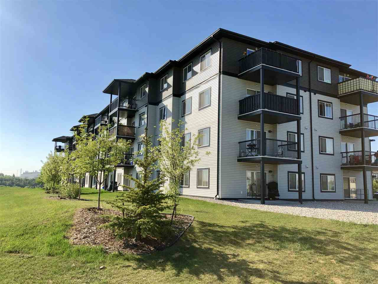 Meticulously maintained condo with panoramic views of the river valley is located on a quiet crescent. This unit is sure to impress on entry with its spacious foyer, open concept living and featuring gleaming dark laminate flooring throughout this area. The kitchen is bright with a large island and loads of counter and cupboard space. The comfy living room/ dining nook space has sliding patio doors to your concrete deck area that over looks the River Valley. The large master suite features a walk through closet to a full ensuite! Completing this condo is another good size bedroom, main full bath, huge pantry/front closet and stackable washer/dryer. There is a portable A/C unit negotiable to stay. The storage room is just outside the unit! Two titled parking stalls one underground and heated that will fit a large vehicle and an outside stall right by the front door.