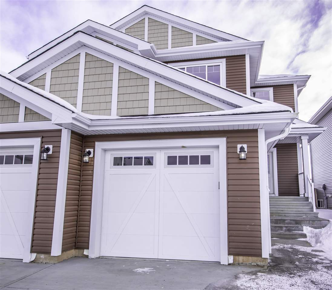 !! Welcome to this magnificent Brand new 2 Storey half duplex located in the desirable community of South Fork in Leduc. The minute you walk in the front door you feel the modern elegance.  This home has everything you could want .The bright main floor features a beautiful open concept floor plan, 9' ceiling, classy kitchen with ample cabinetry, huge pantry & granite counter tops through out, massive Island with eating bar, Back splash tiles, Very Large Dining area leads to fully finished deck. .Living Room Features Gas Fireplace w/Tile Surround. Double door coat closet and 2pc. powder room completes this level. Beautiful Stair case with stainless steel railing leads you to Upper floor, features 2 good sized BEDROOMS, 4 PIECE main BATH, LARGE MASTER BEDROOM with a 4 PC. Ensuite & WALK-IN Closet with organizers. Upstairs laundry... Close to all amenities ... A Must See home .. Priced to Sell !!!