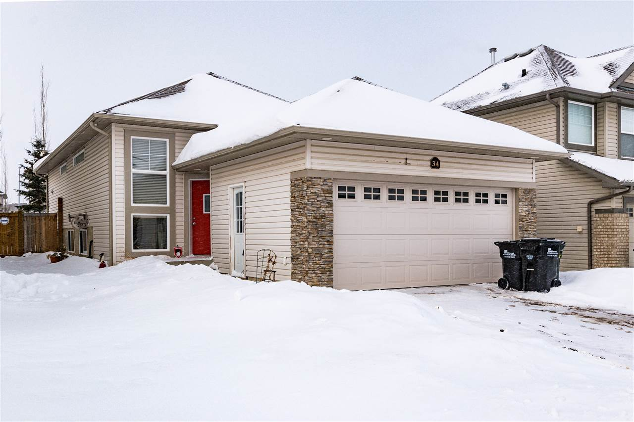 This is definitely a family home, Large master bedroom with full ensuite spa and walk in closet on the upper level.  The main level offers a full bath, second bedroom and a great room concept with the kitchen at the back open to the living area.  The door off the kitchen opens to the back deck and yard.  Downstairs in the developed basement you'll find 2 more great sized bedrooms, large family room with gas fireplace, utility/laundry area and a large crawlspace storage area.  Built in speaker system, and built in vacuum as well  Double attached garage and appliances included.  For the budget conscious you cant get better than this, a must see on your tour.