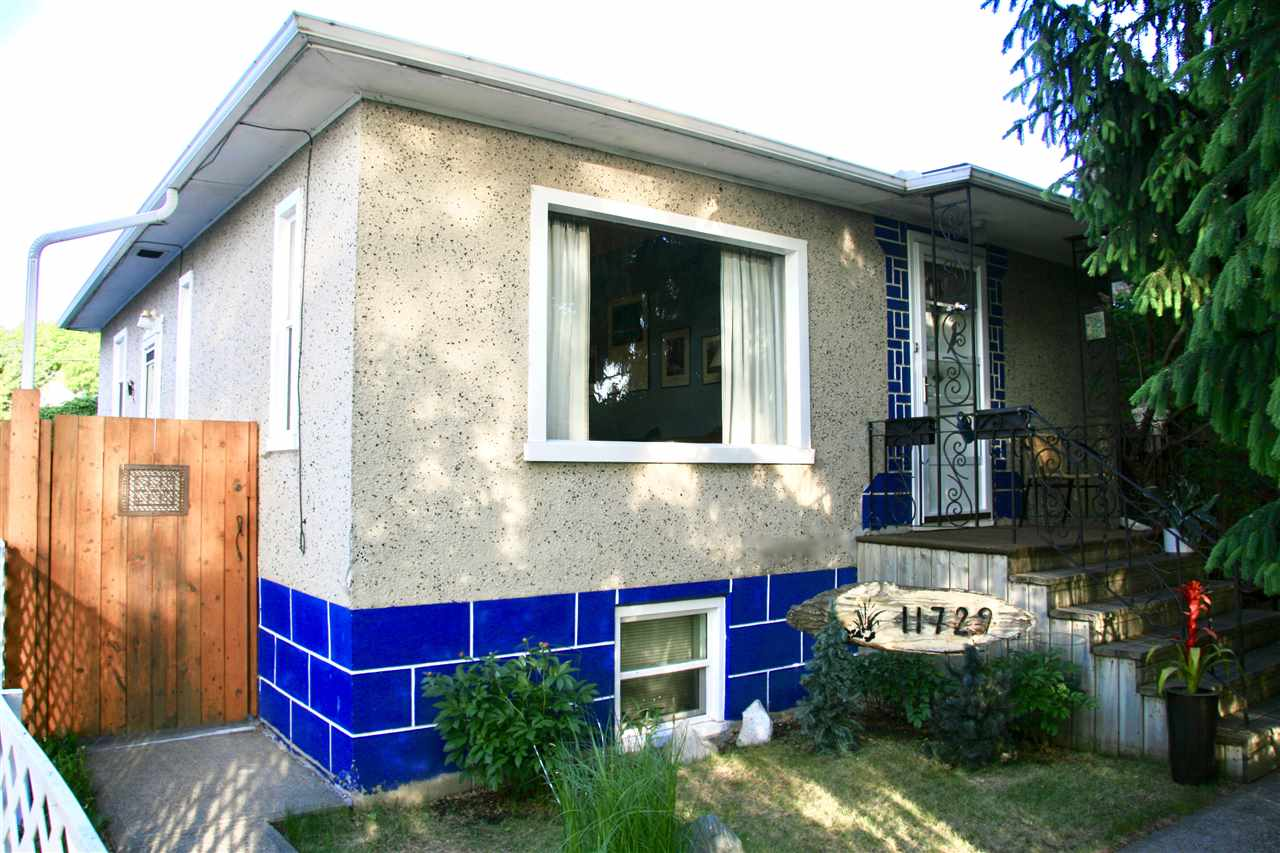 THIS ONE FEELS LIKE HOME!! Welcome to this completely cute, very well maintained home in revitalized Parkdale! PRIDE OF OWNERSHIP is evident as the owner of 34 years has meticulously cared for this property without fail! UPGRADES:  2016-50 YEAR SHINGLES, 2016-UV THERMAL WINDOWS, 2016-STORM DOORS, DRAINLINES CHANGED TO PVC, 2017-100 AMP SERVICE, 2017-ELECTRICAL TO/IN GARAGE, 2017-HWT. Lets start outside...this Stunning Garden Getaway is loaded with perennials, natural grasses, gorgeous meandering stream & pond w/ fountain all landscaped with impressive rock formations, trees etc. Spend many summer days/nights in this wonderful yard - IT WILL FEEL LIKE VACATION! The beautiful tree provides the upmost privacy, & keeps the home cooler in the summer. Heading inside...Character is abundant, w/ curved edges, a faux fireplace centering the cozy living room, & Beautiful Original Hardwood. 2 FULL BATHS! Separate side entrance to a finished bsmt. Summertime caters to festival-goers incl. a Mexican Fest down the st.
