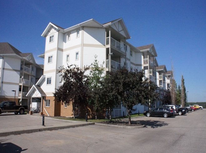 Fantastic LOCATION close to DOWNTOWN shopping. SPECTACULAR River Valley Views and even a view of the Downtown area of Fort Saskatchewan. This complex is located on the River Bank of the North Saskatchewan River and with in walking distance to Co-Op, Movie Theater, Banks, Recreation Facilities, Schools , Parks and Shopping. This unit has just been freshly painted and all NEW carpets installed. TWO bedroom and TWO bathroom apartment condo. In suite laundry with Stainless Steele appliances included too !!! Large Kitchen with corner pantry - eating area and plenty of counter top space and cabinetry . Living room has patio doors off to TOP floor Balcony over looking both the River Valley and the Downtown and Park Land. Flexible possession available either to an Investor or purchaser .