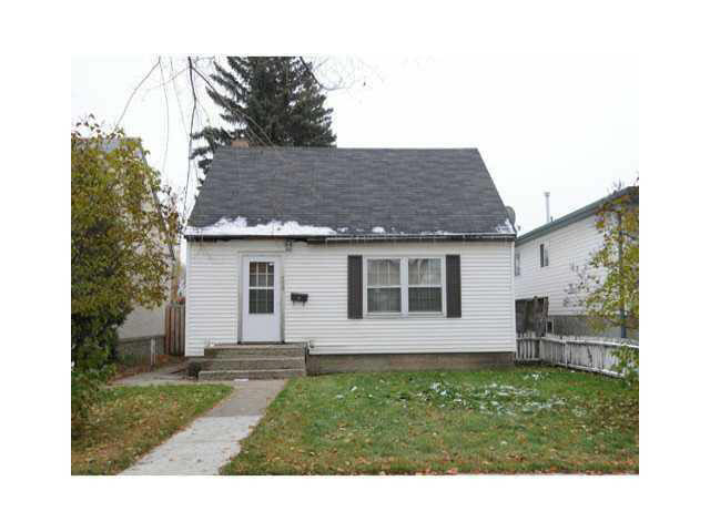 """Look at this for value!!! This is the perfect home for the handyman who doesn't mind putting in a little elbow grease to gain a lot of equity. Two bedroom semi bungalow in central location with new furnace, single garage, hardwood flooring in main floor living room and dining room, two bedrooms up. This home has spacious and bright rooms. The basement is unfinished. This home has great potential for those who don't mind a little elbow grease. All appliances sold in """"as is"""" condition. Convenient location close to the LRT, transit and is in close proximity to Downtown."""