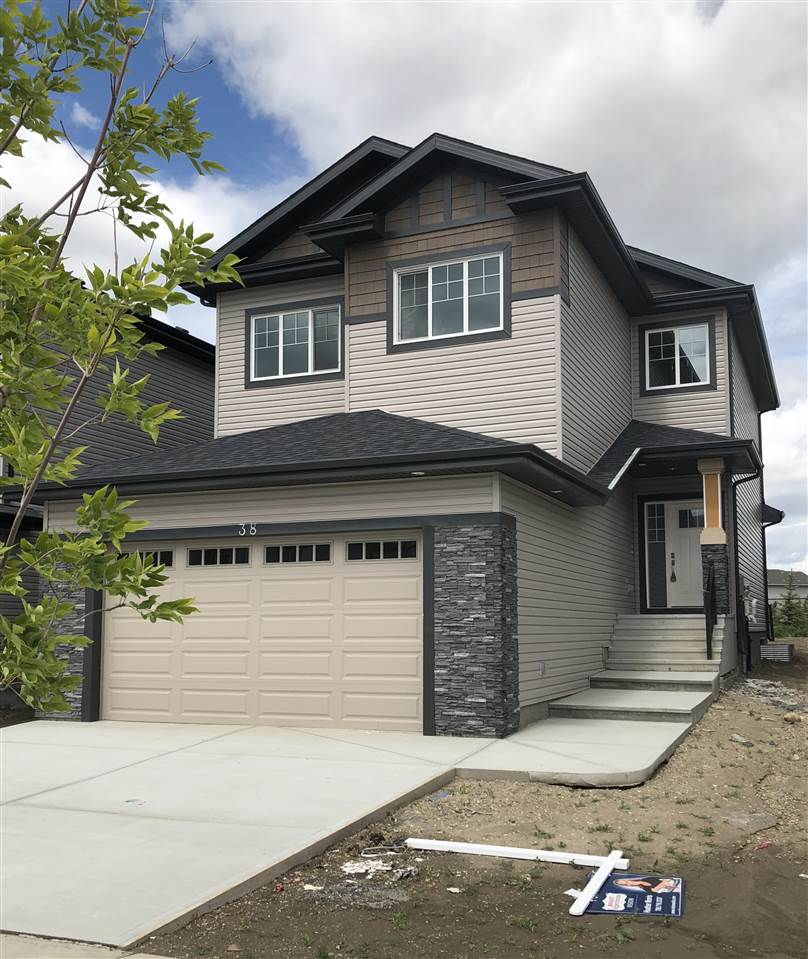 Backing onto greenspace/park!!!!!Welcome home to this stunning two storey with almost 2000 sq ft on the upper two levels and all 3 floors having 9 ft ceilings.Enter into the grand front foyer with 2 storey ceiling. The spacious main floor open concept living area has laminate flooring throughout, a modern grey cabinet kitchen with quartz counter tops and built in SS appliances with huge island space. The bright and cozy living room has a stone facing gas fire place.The dining nook features sliding patio doors to the deck with full view of the park/greenspace behind.Main floor den/flex room and 2 pc bath complete this level.Upstairs you will fine the bonus room with metal railing, huge master suite with walk in closet and 5 pc spa like ensuite.There are 2 other generous size bedrooms, main bath, and laundry room too!The unspoiled basement awaits your finishing touch with a perfectly planned floor print.