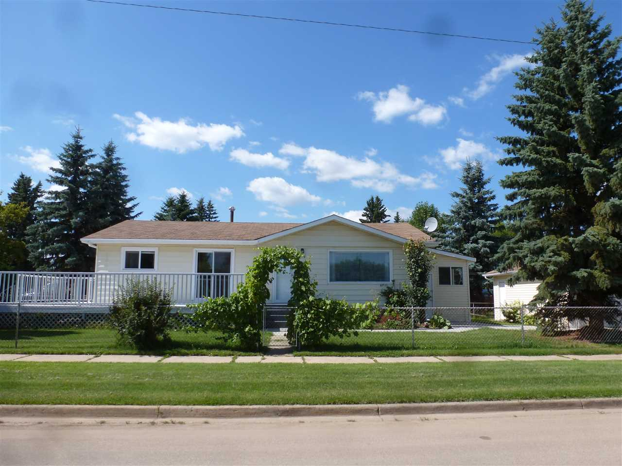 *New Price - $259,900* for this Immaculate Renovated 1965 Bungalow in the terrific Town of Tofield located very close to the schools - walking distance. This fine 1146 Sq Ft family home comes with a 3-Season addition, huge raised deck at the front and a Double Detached Garage at the side. In addition to 3 Bedrooms and two 3-piece Bathrooms, the main floor features an Open Concept with a smart new Kitchen with Breakfast Bar, a Dining area and spacious Living Room. Laundry is on the main floor at the entrance off of the 3-season room. The basement is fully finished and includes   another rather large Bedroom, an open Family Room and a Workshop area. The property is Fully-fenced and landscaped with East-facing Deck and Firepit at the side. Great family home in a town that has everything you need - Schools, Hospital, Shopping, etc. *Formal Dining Room can be converted back to the 3rd Bedroom on the main floor if Buyers prefer.