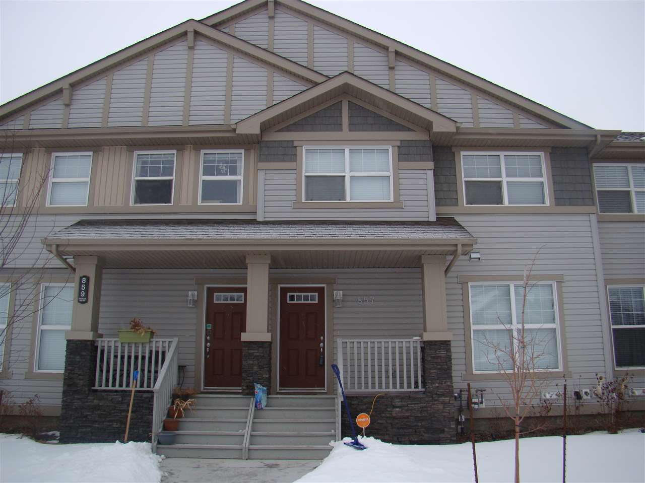 This gorgeous 2-storey townhouse has no CONDO FEES!! As soon as you enter you are greeted by a wide open floor plan with a huge island kitchen with loads of counter space and stainless steel appliances. There is also a dining room which can accommodate a good size table, a 2pc bath, a bright living room and hardwood thru out the main floor. Upstairs you will find the huge master bedroom with a walk in closet and a beautiful 3pc bath, another 4pc bath and another 2 generous size bedrooms. The back yard is landscaped and features a double garage. The location is fantastic as it is across the street from a lake, walking trails and backing onto a green space. Just move in and Enjoy.