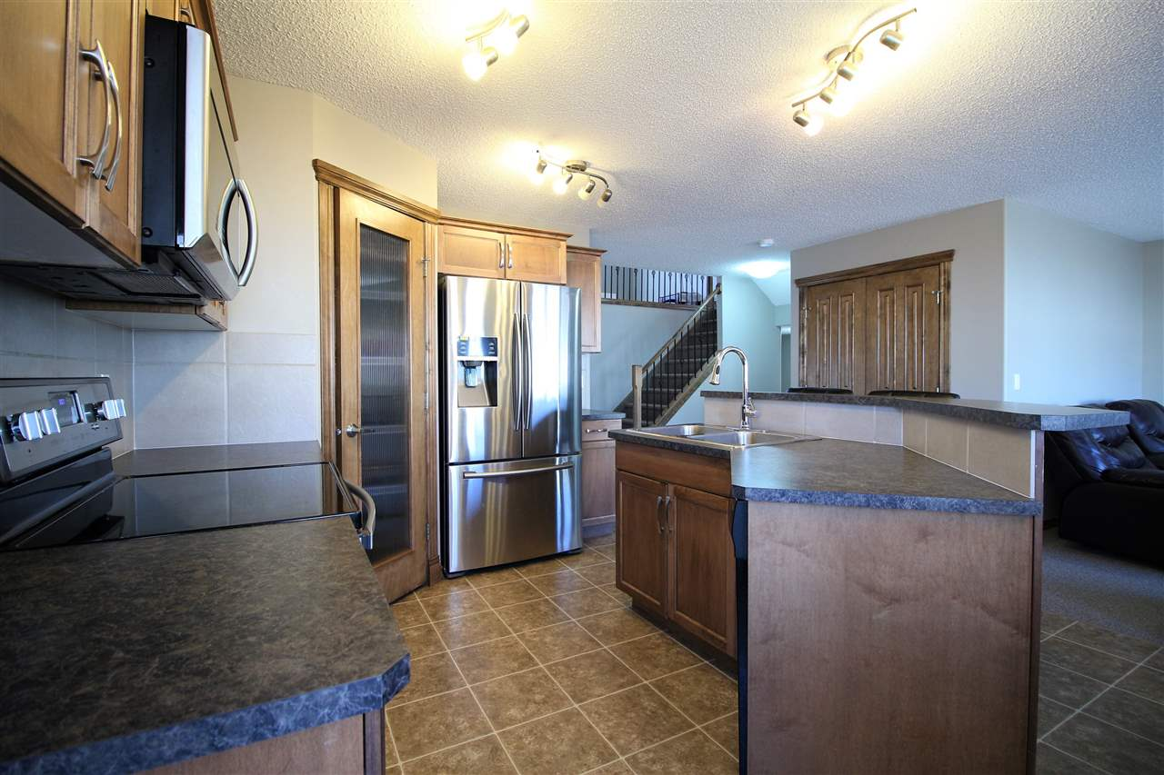 New family wanted for Harvest Ridge home! With 1800+ sq ft this beautiful home features a double attached garage, air conditioning, bonus room, fresh paint throughout, landscaped back yard and so much more! You will notice the open concept main floor is great for entertaining. Upstairs is where you will find the massive bonus room, upstairs laundry, 3 bedrooms and 2 full bathrooms including your 4 piece master en-suite! Head out the back door onto your massive back deck and landscaped yard! The basement is awaiting your creative touch, just bring your imagination!