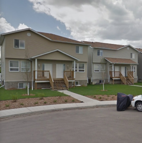 Awesome superior built bare land condo. This three bedroom 2 storey half duplex condo is the Perfect family home, close to schools, playground and transit.  Unspoiled basement awaiting your personal touch.  Expansive grounds with two assigned parking stalls + visitors parking.  Lots of young families.