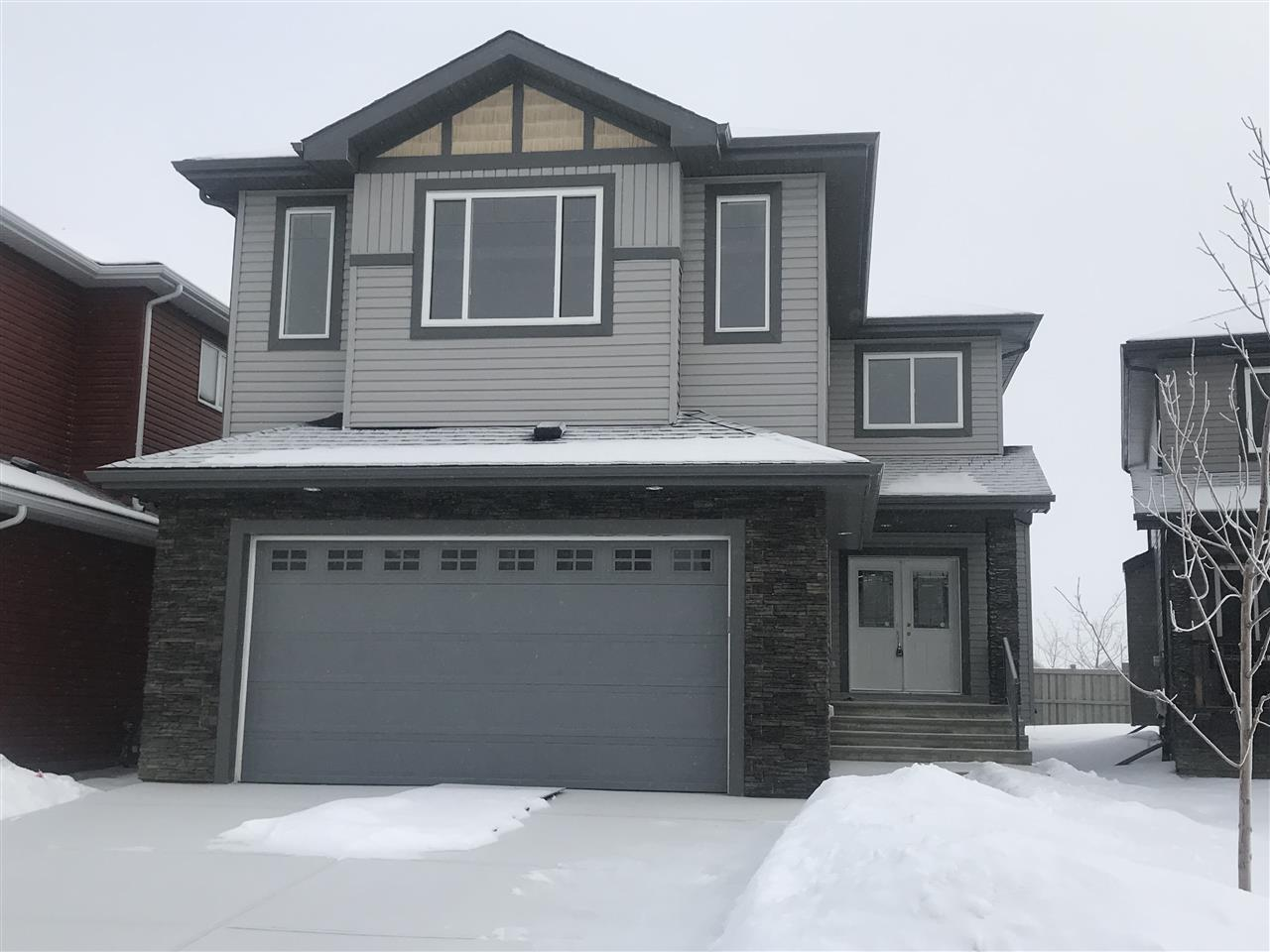 Stunning 2 Storey HOME in CREELWOOD CHAPPELLE! 2485 SQ FT BRAND NEW HOME WITH 3 BEDROOMS AND 3 FULL BATHROOMS. Welcoming you into this home is a set of DOUBLE DOORS and a very open Foyer. The main level offers Hardwood and Tile throughout. The Living Room boasts of a GAS F/P with TILE SURROUND TO THE 18' CEILING. The KITCHEN has GRANITE CT, HUGE ISLAND, a WALK THROUGH PANTRY and UPGRADED HIGH END SS APPLIANCES. The bright and spacious Main Level DEN is ideal for a HOME OFFICE. The Dining leads to a deck accessorized with a GAS LINE for BBQ. Main floor laundry & 3 piece Bath complete the main. Upstairs has been crafted with attention to detail. Upper level offers a LARGE MASTER with luxurious Ensuite w/Dual Sinks, soaker tub, Glass Shower + Large Walk-In Closet. 2 Additional bedrooms, 4-Piece Bath, & Huge BONUS ROOM with Coffered Ceiling perfect for entertaining. The home has speakers throughout connected via a central system. Oversized garage. 9' ceilings on main and in the basement. A DEFINITE MUST SEE!!