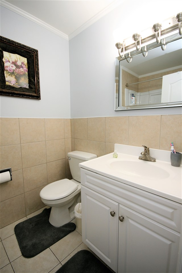 The upper washroom has also been upgraded with newer vanity, ceramic tile accents, a deep soaker tub and upgraded lighting.