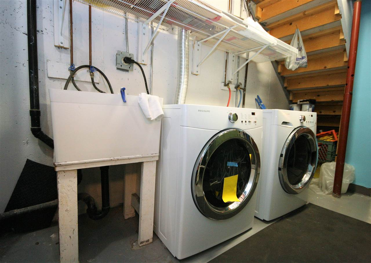 The laundry/mechanical room features a front load washer and dryer, a laundry sink and a handy hobby room/storage area for all of your extras.  This basement also has a cold room for additional storage.