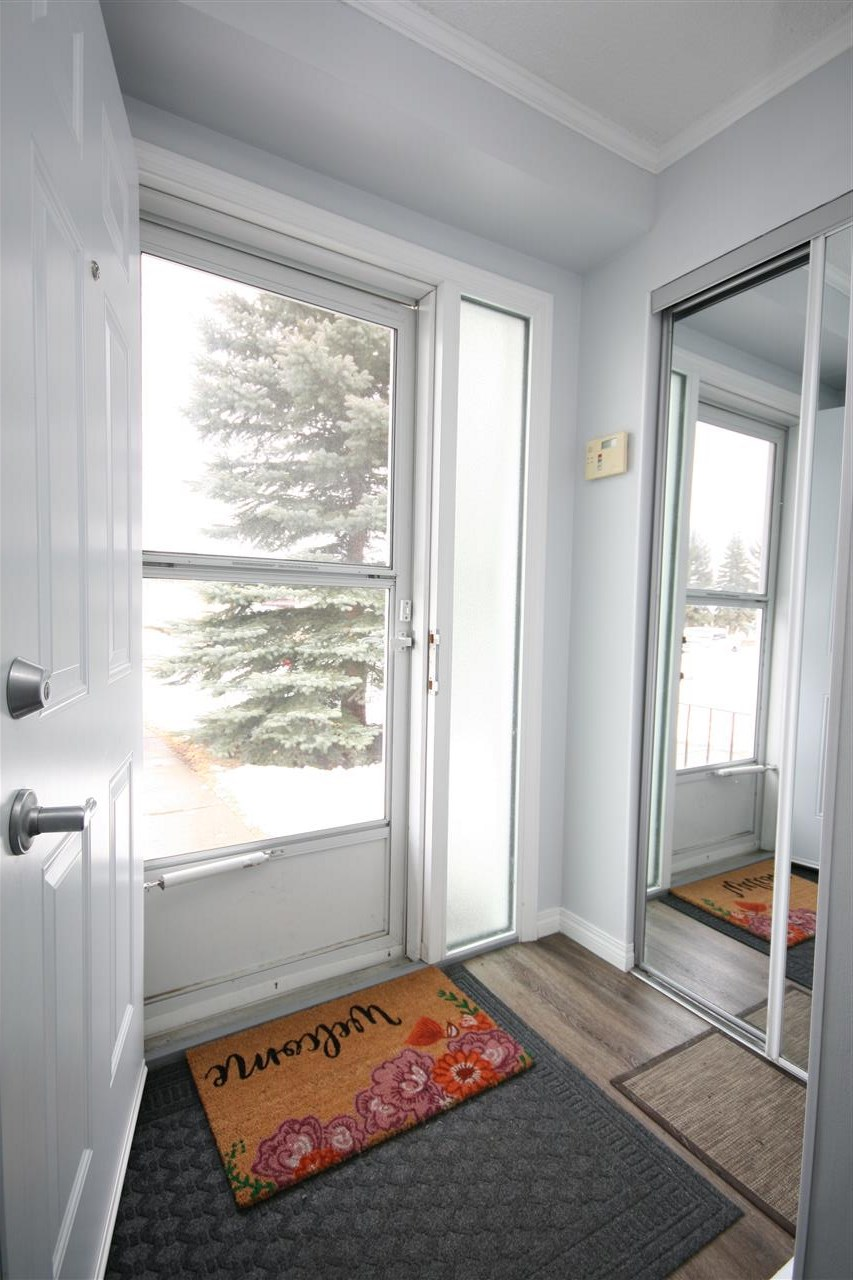 Front door leading to the front street.  This home comes with one energized stall, but there is also plenty of room for extra vehicles right in front of your unit!