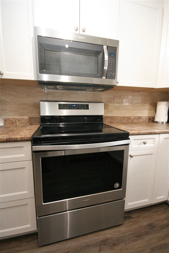 Matching Whirlpool ceramic top, convection range and overhead microwave/hood fan.