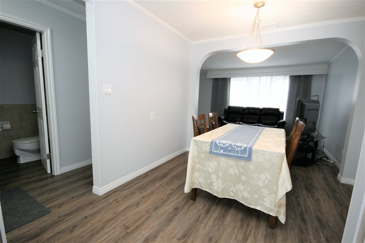 Modern, vinyl plank flooring extends from the kitchen and through the rest of the main floor.