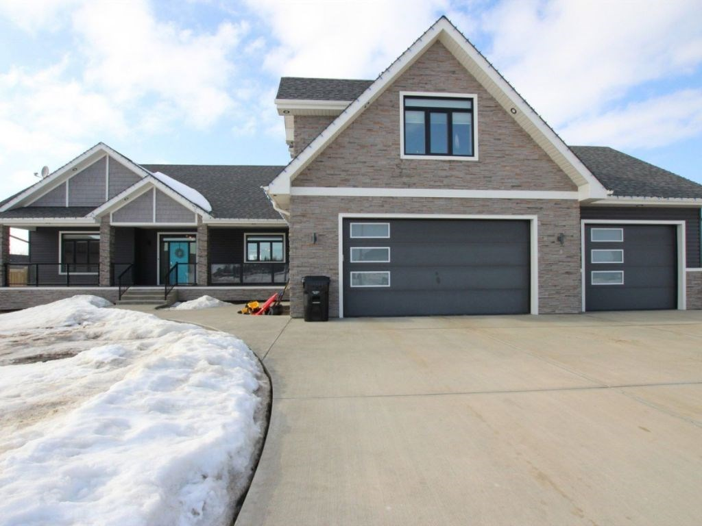 Incredible custom built home, located in the friendly community of New Sarepta. Only 15 minutes from Beaumont, 25 minutes from Leduc, the EIA, Sherwood Park, and South Edmonton. No city traffic, with dual access off of Hwy 21. Playschool, Elementary, Junior High, High school, Agriplex, and Library, all a short walk away. This house includes a triple attached heated garage, situated on a .80 acre pie lot with city water and garbage/recycling pick-up. Spacious living, with open concept kitchen and living room under a vaulted ceiling. Main living area flooring is Wicander vinyl comfort plank flooring. This dream kitchen includes quartz counter tops, stainless steel appliances, pullout drawers, numerous kitchen organizers, a pantry and a huge island. Includes a dual fuel range (gas cook top and electric oven with warming drawer), sub zero over sized fridge, wine cooler and mini fridge.