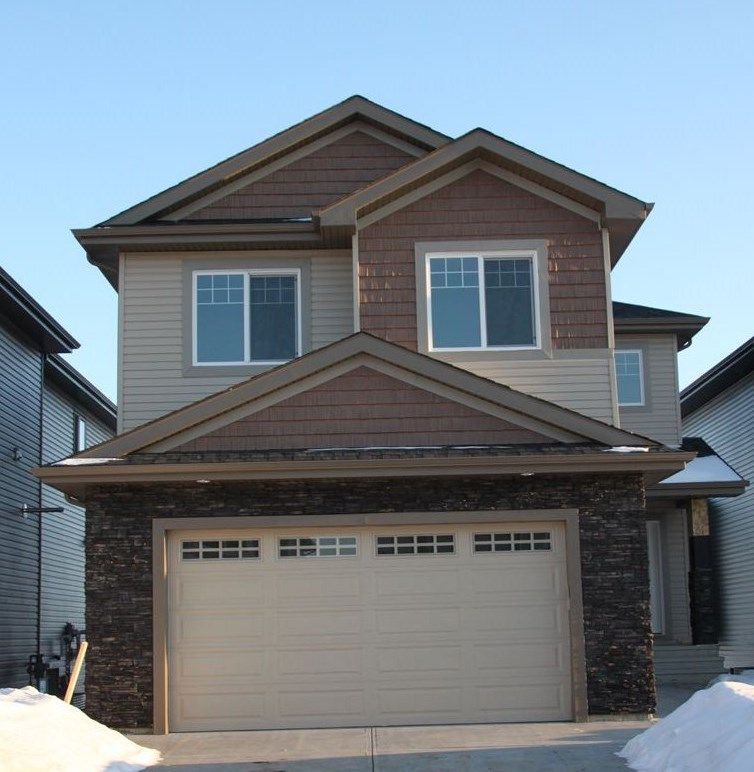"Welcome to This gorgeous BRAND NEW 3 bedroom home on WALKOUT lot, Approx 2600 SF of living space.South facing Backyard, Located in a quiet & cul de sac community Of Creekwood Chapelle, HIGH END FINISHINGS throughout. 24X24 Tiles & Engineered Wood, also included; 9' ceilings, 8' Doors, Flex Room/ Den on main with Full Bath, Quartz Counter tops throughout,Built In wall SS Appliance pkg, 36"" Gas Cook top, Huge Island, Family room c/w designer fireplace & oversized windows. Glass Maple Railing leads you to 2nd level with Huge Bonus room, 3 Bedrooms & Laundry Room with sink & Cabinets. Master Suite includes Spa like en suite with walk thru walk in Closet.Triple Pan Windows, HRV System, Built in Sound System on both levels with speakers on Rear Deck.4 Zone Sound Controls.Upgraded Flooring & Lighting Fixtures. Unspoiled Walkout Basement. Creek Wood is growing community with exclusive events access to residents of Chapelle in Newly built Community Center. New Commercial Development Close by. A Must See, Shows 10."