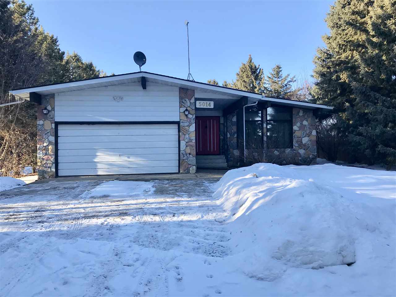 This beautiful and spacious 1350 sq ft family home is situated on a 75' x 220' (0.38 acres) treed lot and features 3+2 bedrooms, 3 bathrooms and a 90% finished basement. The main floor has a huge bright living room with vaulted ceilings and a formal dining area, nice kitchen with an eating nook overlooking the beautiful back yard, 3 good sized bedrooms, 2 bathrooms and a separate entrance to the basement. In the basement you will find a large family room, wet bar, 2 bedrooms - one bedroom needs paint, trims, and carpet (this is the one unfinished room in the house), 2-p bathroom, laundry room, work shop area, utility room and plenty of storage. The home had some recent renovations done and they include newer carpets throughout the upstairs, linoleum in entry, hallway and bathrooms upstairs, fresh pain upstairs and downstairs, vanity in master bath, deck and shingles in 2009. Located away from the railroad tracks and only 20-30 minuted from the City of Edmonton, Nisku and Sherwood Park. A must see!!!
