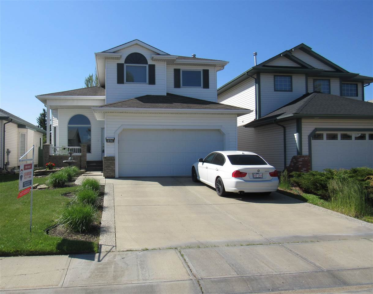 STUNNING is the only way to describe this home, located in the highly sought after community of Blackburne. This OPEN CONCEPT home has been meticulously looked after and pride of ownership is very evident as you walk in.  The main floor offers a formal dining area with vaulted ceilings and is open to a CAT WALK above. The living room offers very high ceilings, a fireplace and HUGE ARCH WINDOWS, resulting in lots of natural light flowing through the home.  The kitchen comes with high end S/S appliances, lots of counter space, plus island and a walk in pantry. Upstairs is a very unique cat walk which leads to the master bedroom with french doors, walk in closet and a 3 piece en suite. Also on the 2nd level are 2 more bedrooms, 4 piece bath with jacuzzi tub and a large laundry room. The basement is fully finished with a large bedroom, family room and a stunning spa like bath. The south facing back yard is lovely, it's been carefully landscaped and offers a composite deck, mature tree's, pond and walkway.