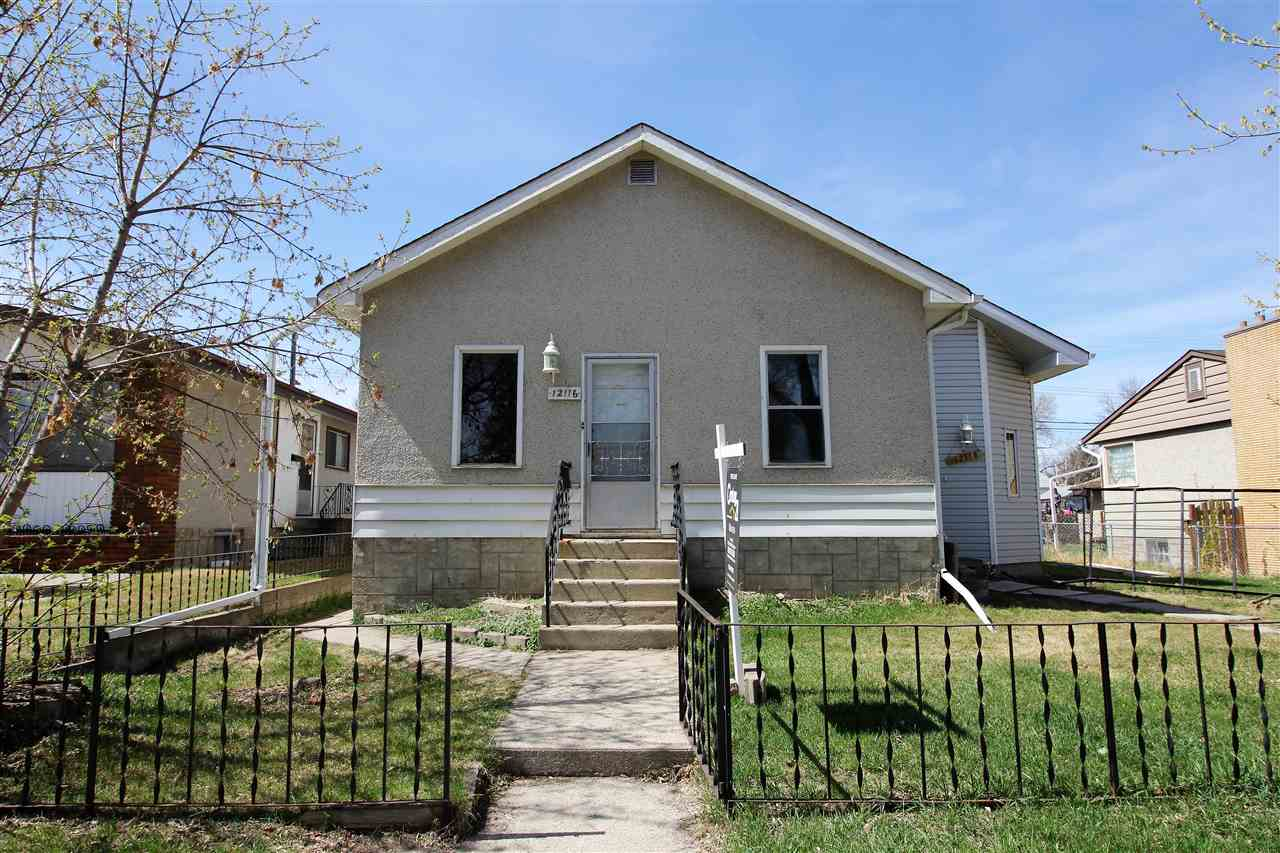 INVESTMENT OPPORTUNITY! This property could be a large single family home or future revenue property. The home needs work but it's a unique property on a large 52' x 124' lot on a nice residential street across from Beacon Heights Elem School, park & playground. Great access to public transit, Yellowhead & 50th St. Currently the main floor has a Kitchen w/walnut cabinets, Dining Rm, Small Bd or Den & a Huge Living Rm w/a large rear facing picture window & 2 skylights. The 4 pce bath has had some recent upgrades. Main floor laundry. Upstairs are 2 large Bds & an enclosed verandah the width of the 2nd floor w/a separate gas heater. The basement has a separate entrance & offers loads of space for future development w/partially fin LR, BD, Kit, 3 pce Bath & Laundry. The main floor Kitchen leads to a big wood deck & an oversized single garage w/newer OH door. Furnace is 20+ yrs & HWT 12+ yrs. Solid Foundation. Current zoning is RF1 but this property is suitable for redevelopment.