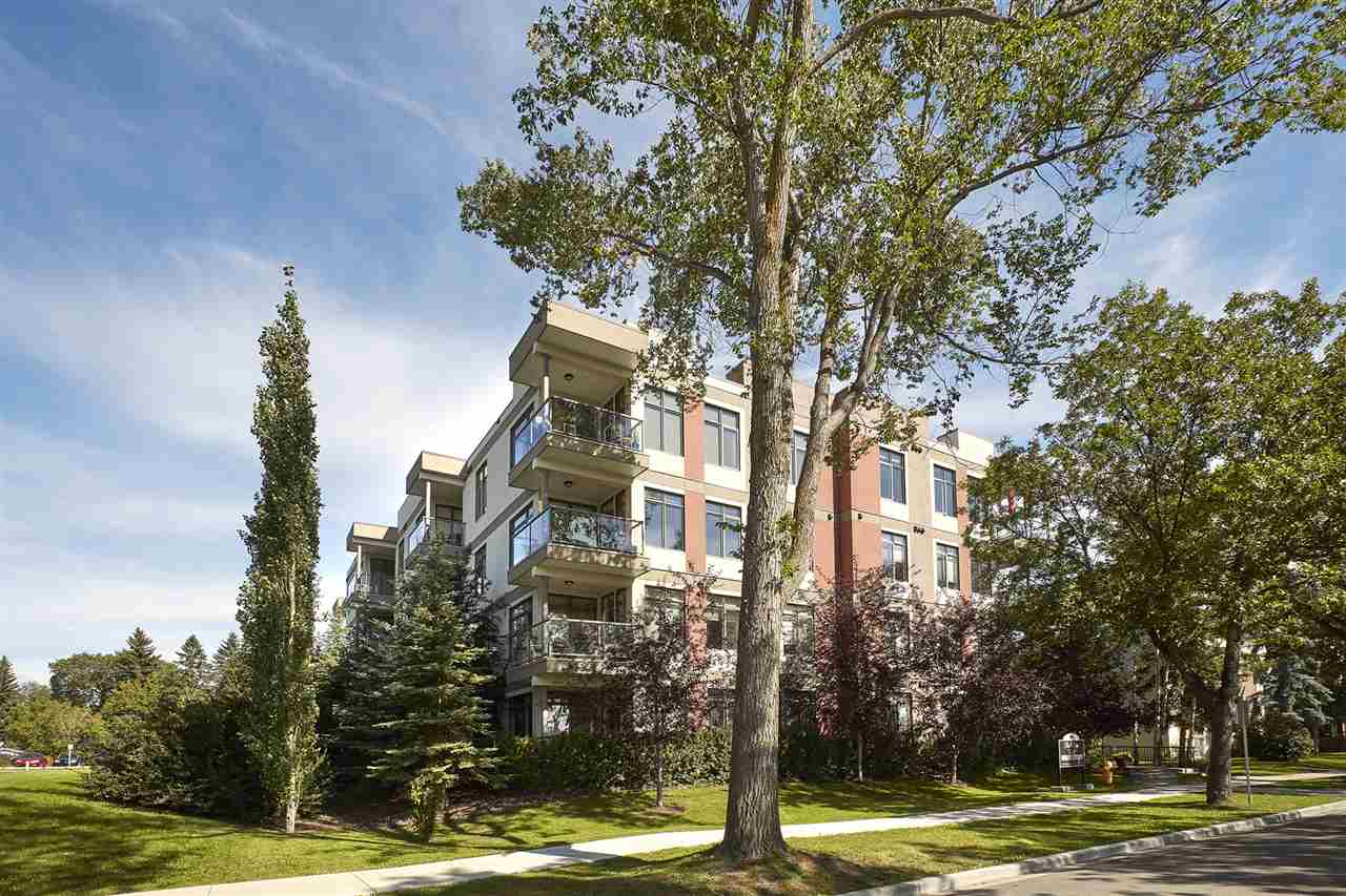 Welcome to Park One West in Parkallen!! This gorgeous Top Floor condo has 967 sqft of living space; 2 bedrooms, 2 bathrooms & 2 titled parking stalls, the perfect condo! Entering the unit you will love the bright & open feeling with floor to ceiling windows in the main living area that fill the home with natural light (10ft ceilings throughout). The kitchen features maple cabinets, granite countertops, ceramic tile backsplash, stainless steel appliances & a breakfast bar. The kitchen is open to the large dining area & living room with a corner fireplace. The spacious master bedroom has a large walk-in closet & 3 piece ensuite. The second bedroom is a good size with the 2nd bath right next to it. Relax outside & enjoy the beautiful view on the west facing covered balcony with a gas outlet for your bbq. You will appreciate the convenience of 2 underground parking stalls & storage lockers, as well as in-suite laundry. Park One West is just minutes from Whyte Ave, UofA, shopping & Belgravia LRT station.
