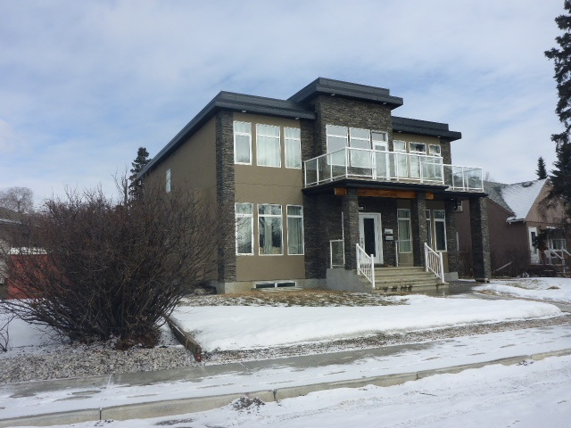 """Beautifully constructed, versatile home, in terms of usage. Could be home owner occupied with a large basement legal suite with 2 bedrooms with full ensuite, family room, spacious living and dining room, kitchen. Separate entrance. A """"huge"""" vestibuled entrance with 12""""x24"""" tiles and in-floor lights, 9' ceilings, pillars. Main floor has a living room with full ensuite. Second floor has a family lounge / library with balcony, 4 bedrooms with full ensuite one with a Jacuzzi tub. There is an 11'8"""" x 10'6"""" space opens to the main floor from the second floor. There is an elevator shaft for future development. The property can be used with application to the city of Edmonton, for congregate living. it could also be a group home. Flooring consists of tiling, laminate and plush carpeting."""