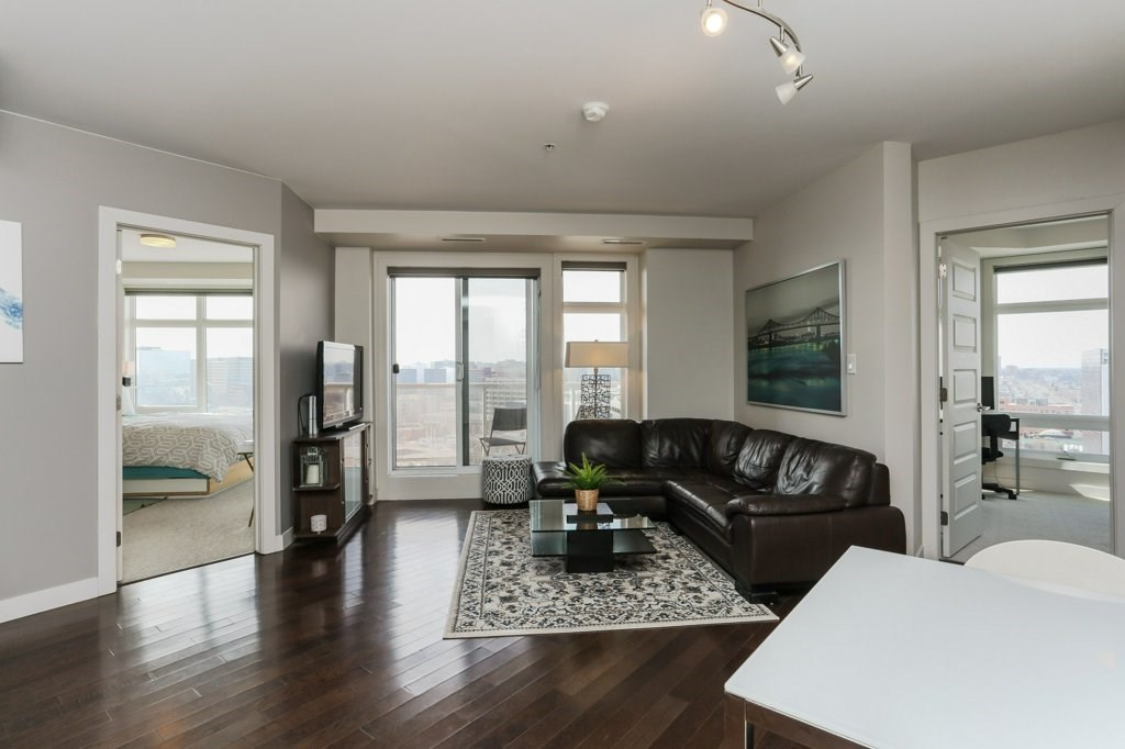 Convenience & Freedom! Quest - 1 Block SW of Rogers Place & the new Ice District this 2 Bed, 2 Bath condo WILL impress. Featuring a desirable floor plan featuring a LRG, beautiful, functional kitchen, High-end finishes, SS appliances, granite counters, custom cabinetry, neutral paint throughout, plus hard wood flooring in the main space with abundant natural light. Completely self-contained, its own forced air furnace, humidity control & fully air-conditioned in a building equipped w/advanced state-of-the-art security system and on site management that brings comfort to the next level. Perfectly positioned just STEPS TO ALL AMENITIES, fine foods, sporting events, concerts and live performances in addition to Grant MacEwen University and the new Light Rail Transit Station - allowing access to anywhere in the city in just minutes. In-Suite Laundry, TWO Titled UG Parking & Private patio with city views. This property has it all! A complete community - live, learn, work and play!